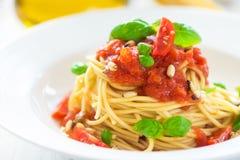 Espaguetes com tomates Imagem de Stock Royalty Free