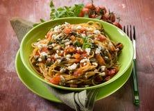 Espaguetes com tomates e queijo Foto de Stock