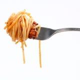 Espagueti boloñés en fork Fotos de archivo
