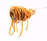 Espagueti boloñés en fork Imagen de archivo libre de regalías