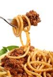 Espagueti boloñés en una fork Fotos de archivo