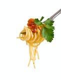 Espagueti boloñés en una fork Imagen de archivo