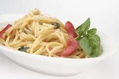 Espagueti con el tomate fresco Imagenes de archivo