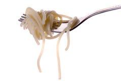 Espagueti con grawy en el primer de la fork imágenes de archivo libres de regalías