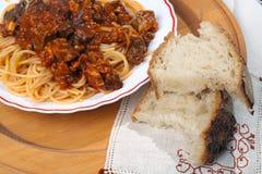 Espagueti con Soffritto y pan Foto de archivo