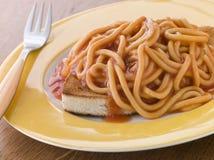 Espagueti en tostada Foto de archivo