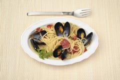 Espaguetis con los mejillones Fotos de archivo libres de regalías