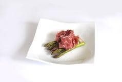 Espargos e presunto de Parma fotos de stock