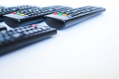 Especially heavily blurred black remote controls for the TV on a white background royalty free stock image