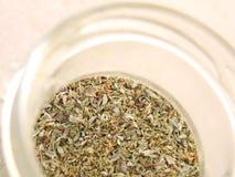 Especiaria do Oregano no frasco imagem de stock