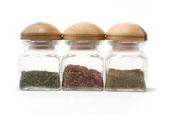 Especiarias do aroma em uns frascos Fotografia de Stock