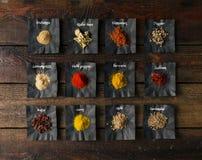 Especias coloridas en la tabla de madera Imágenes de archivo libres de regalías