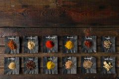 Especias coloridas en la tabla de madera Fotos de archivo libres de regalías