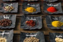 Especias coloridas en la tabla de madera Foto de archivo libre de regalías