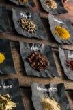 Especias coloridas en la tabla de madera Imagen de archivo libre de regalías