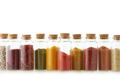 Especias en botellas imágenes de archivo libres de regalías