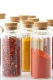 Especias en botellas foto de archivo