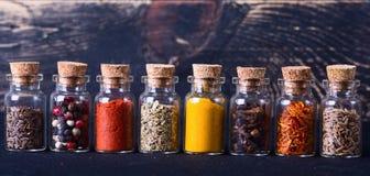 Especias en botellas Foto de archivo libre de regalías