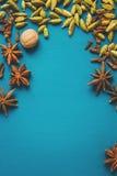 Especias en una tabla azul Fotografía de archivo