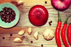 Especias Pimienta, ajo, cebollas, perejil Imagenes de archivo