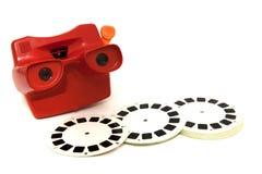 espectador de diapositiva 3D, cámara del juguete con el rollo de película 3D Imagenes de archivo
