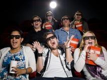 Espectadores asustados de la película Foto de archivo
