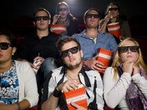 Espectadores asustados de la película Imagen de archivo libre de regalías
