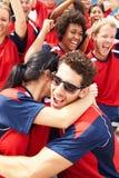 Espectadores de los deportes en Team Colors Celebrating Imagen de archivo libre de regalías