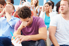 Espectadores desapontados no evento de esportes exteriores Foto de Stock