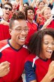 Espectadores en Team Colors Watching Sports Event Foto de archivo libre de regalías