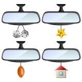 Espejo de coche fijado con diversas decoraciones Fotografía de archivo libre de regalías