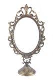 Espejo oval del metal del vintage Foto de archivo