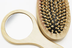 Espejo y cepillo para el pelo Fotos de archivo