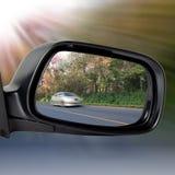 Espelho de carro na estrada Imagem de Stock Royalty Free