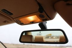 Espelho de rearview do carro com luzes Imagem de Stock Royalty Free