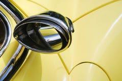 Espelho de Rearview no carro amarelo Fotos de Stock