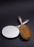 Espelho e pente de prata Imagem de Stock Royalty Free
