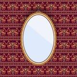 Espelho oval em um quadro na parede com papel de parede modelado Fotos de Stock Royalty Free
