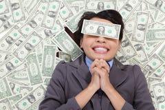 A esperança da mulher de negócio seja rica Imagens de Stock Royalty Free
