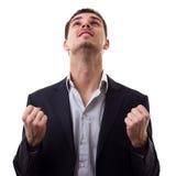 Esperando o homem novo com seus dedos cruzados Imagens de Stock Royalty Free