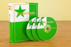 Esperanto language textbook and CD discs on the wooden table. 3D. Esperanto language textbook and CD discs on the wooden table Royalty Free Stock Images