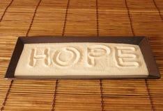 Esperanza en la arena Fotos de archivo libres de regalías