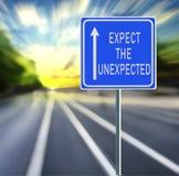Espere o sinal de estrada inesperado em um fundo rápido com por do sol imagens de stock royalty free