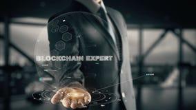 Esperto in Blockchain con il concetto dell'uomo d'affari dell'ologramma Fotografie Stock Libere da Diritti