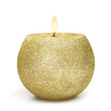 Espheric golden candle. Shiny candle lighting on withe background in gold color Stock Photography