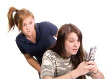 Espiar do telefone de pilha Foto de Stock