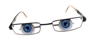 Espiar dos olhos de vidros fotografia de stock