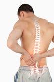 Espina dorsal destacada del hombre con dolor de espalda Imágenes de archivo libres de regalías