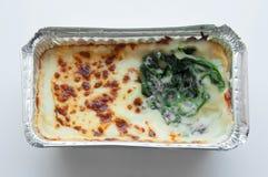 Espinaca cocida con queso en paquete del froid Fotografía de archivo libre de regalías