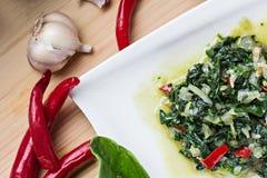 Espinaca con las verduras Imagenes de archivo